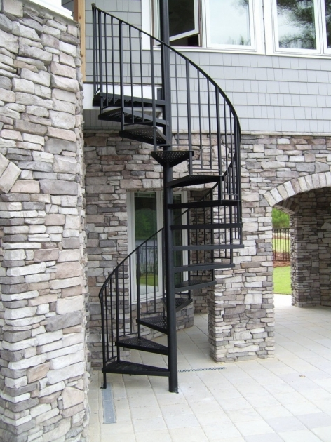Spiral Staircases Exterior Design Ideas Using Outdoor Black Iron Spiral Staircase Along With Grey Stone Veneer Pictures 12