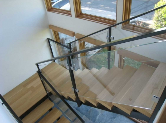 Staircase Steel Railing Designs With Glass Interior With Brushed Stainless Frame And With Wooden Steps By Rempe Construction Images 00
