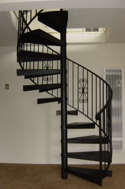 Metal Staircase Design Modern Ideas With A Circular Shape Made Iron Colored Black With Iron Fence Designthat Has Flower Shaped Decoration Pictures 59