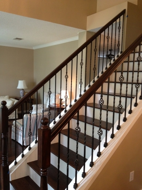 Wrought Iron Stair Railing With Wooden Accents On Its Holders For Home Ideas Image 45
