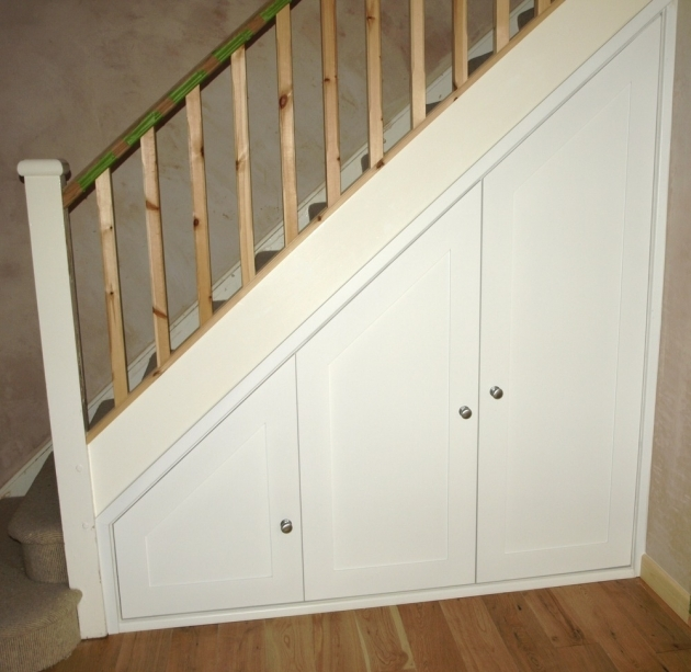 Under Stairs Storage Ideas With White Wood Door Cabinets Along With Wooden Floor Pictures 01